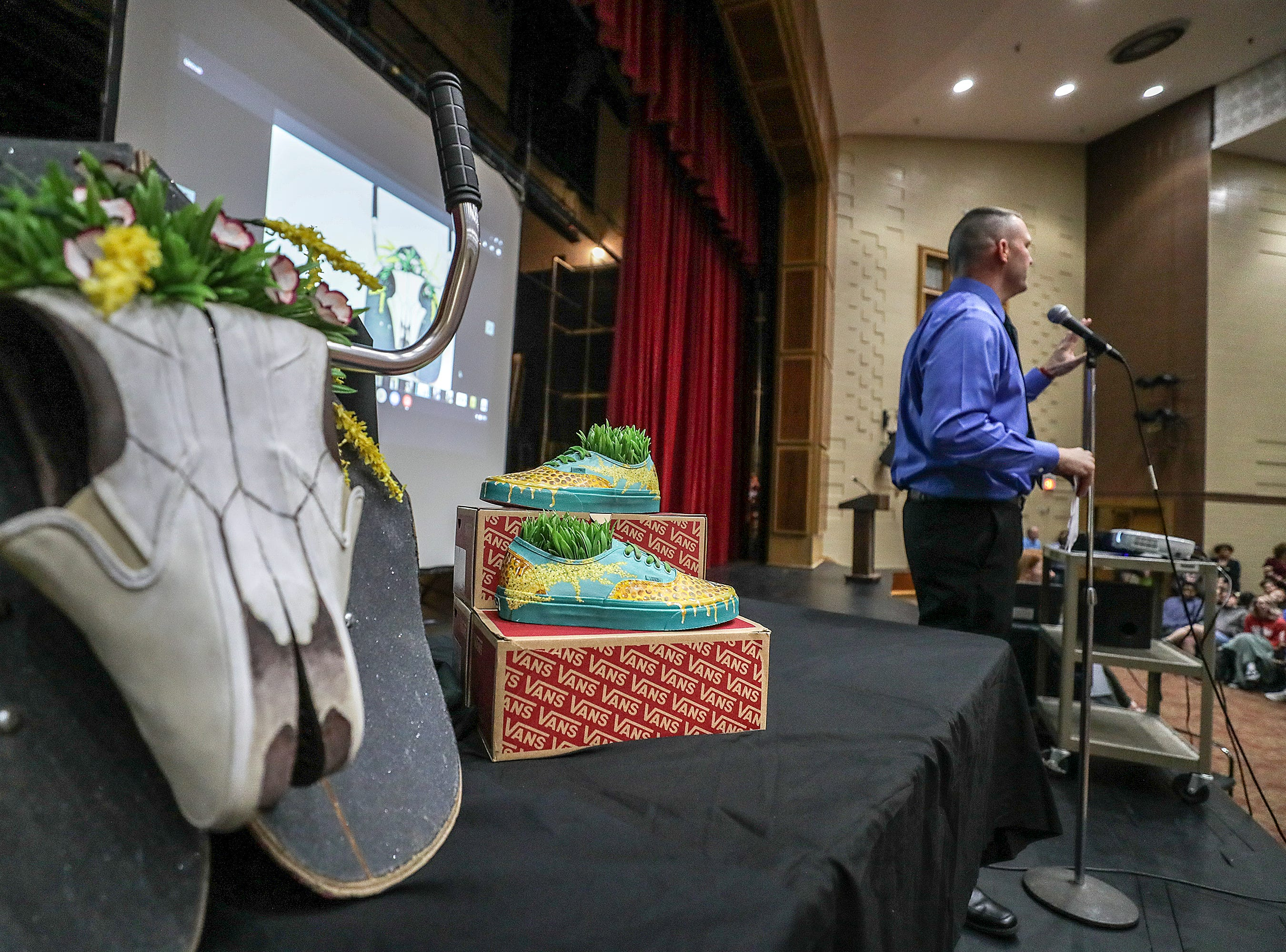 Atherton principal Tom Aberli kicks off a school assembly on Tuesday morning to learn whether the school had won the grand prize from Vans as part of their Custom Culture contest where students used the distinctive footwear to design shoes that depict their state.  Atherton was one of the runner ups and received $10,000 from Vans.May 14, 2019