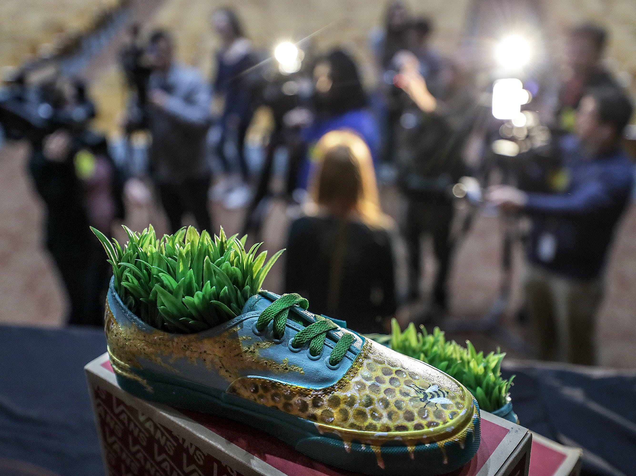Atherton teacher Rachel Gibbs talks with the media after an assembly as part of the Vans Custom Culture contest.  The contest had students use the distinctive footwear to design shoes that depict their state.  Atherton was one of the runner ups and received $10,000 from Vans.May 14, 2019