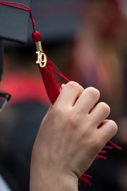 Louisville native Clay Harville, adjust his graduation tassel before the Topper Walk at Western Kentucky University. May 11, 2019