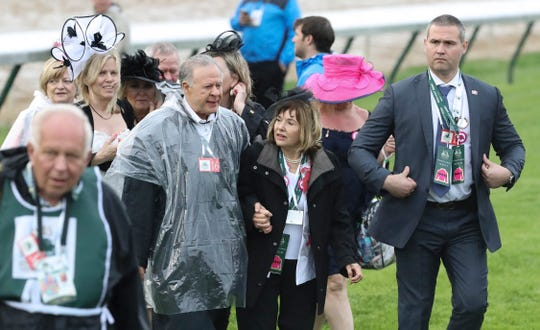 Maximum Security owners Gary and Mary West (center) make their way to the winners circle after jockey Luis Saez led the pack to finish first in the Kentucky Derby at Churchill Downs, but was later disqualified and Country House was declared the winner.