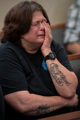 Mary Hanyes holds back tears during the first day of trial in Elizabethtown, Kentucky for the 2017 death of her nephew Hunter Payton, a four-year-old that died from head injuries while in the foster care of Billy and husband Travis Embry-Martin. May 13, 2019