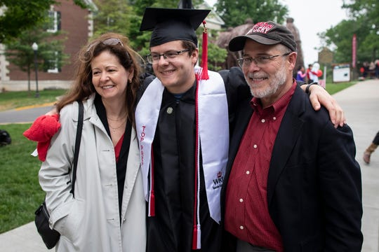 Mary Harville, from left, stands with her son, Clay Harville, and husband Brad Harville for a portrait before the start of the Topper Walk at Western Kentucky University. Harville is the first to graduate from WKUÕs autism program with a degree in special education teaching. May 11, 2019