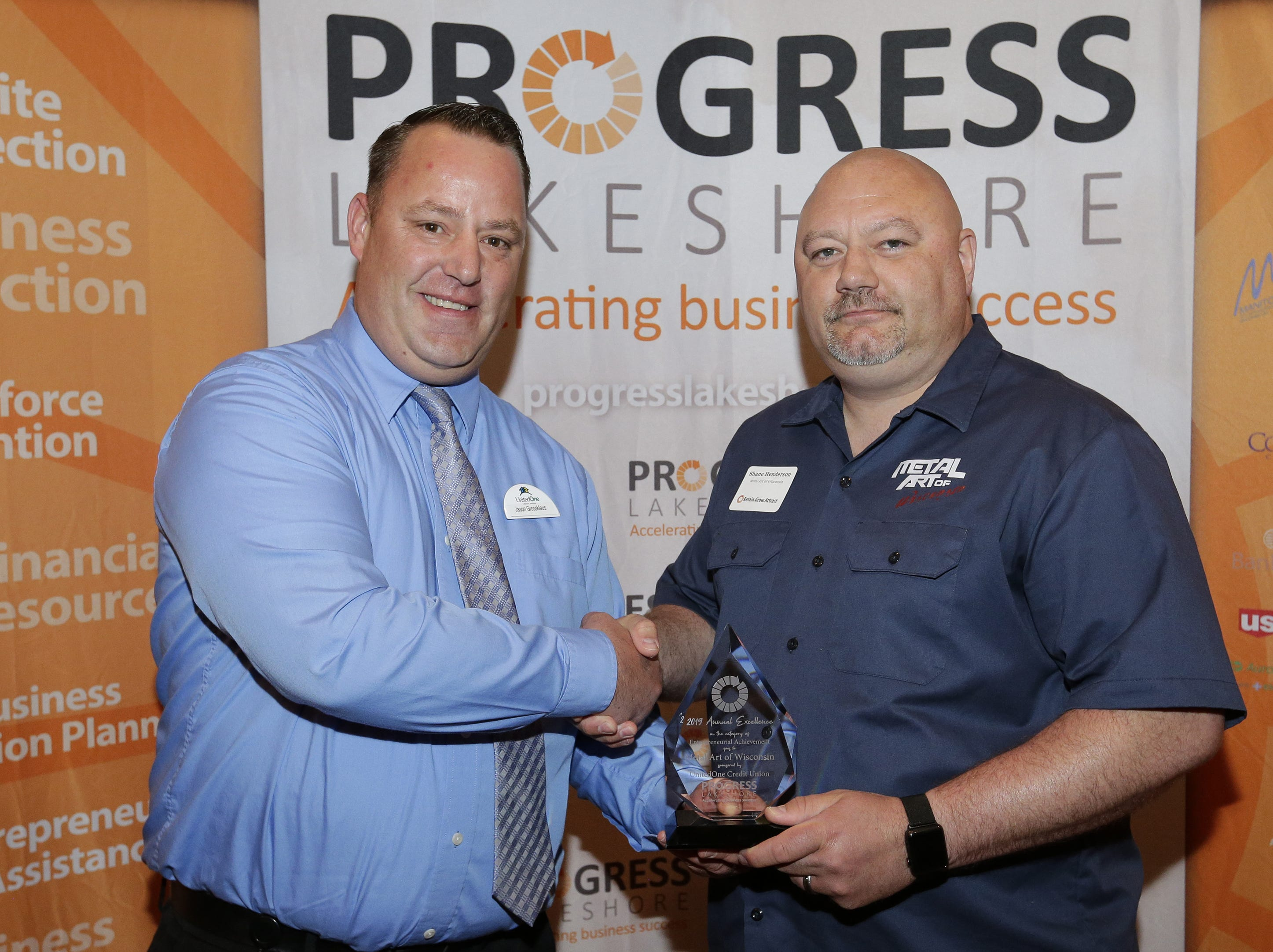 Sponsor Jason Grossklaus presents the Entrepreneurial Achievement Award to Metal Art of Wisconsin's Shane Henderson during the Progress Lakeshore Awards Breakfast at the Holiday Inn Tuesday, May 14, 2019, in Manitowoc.