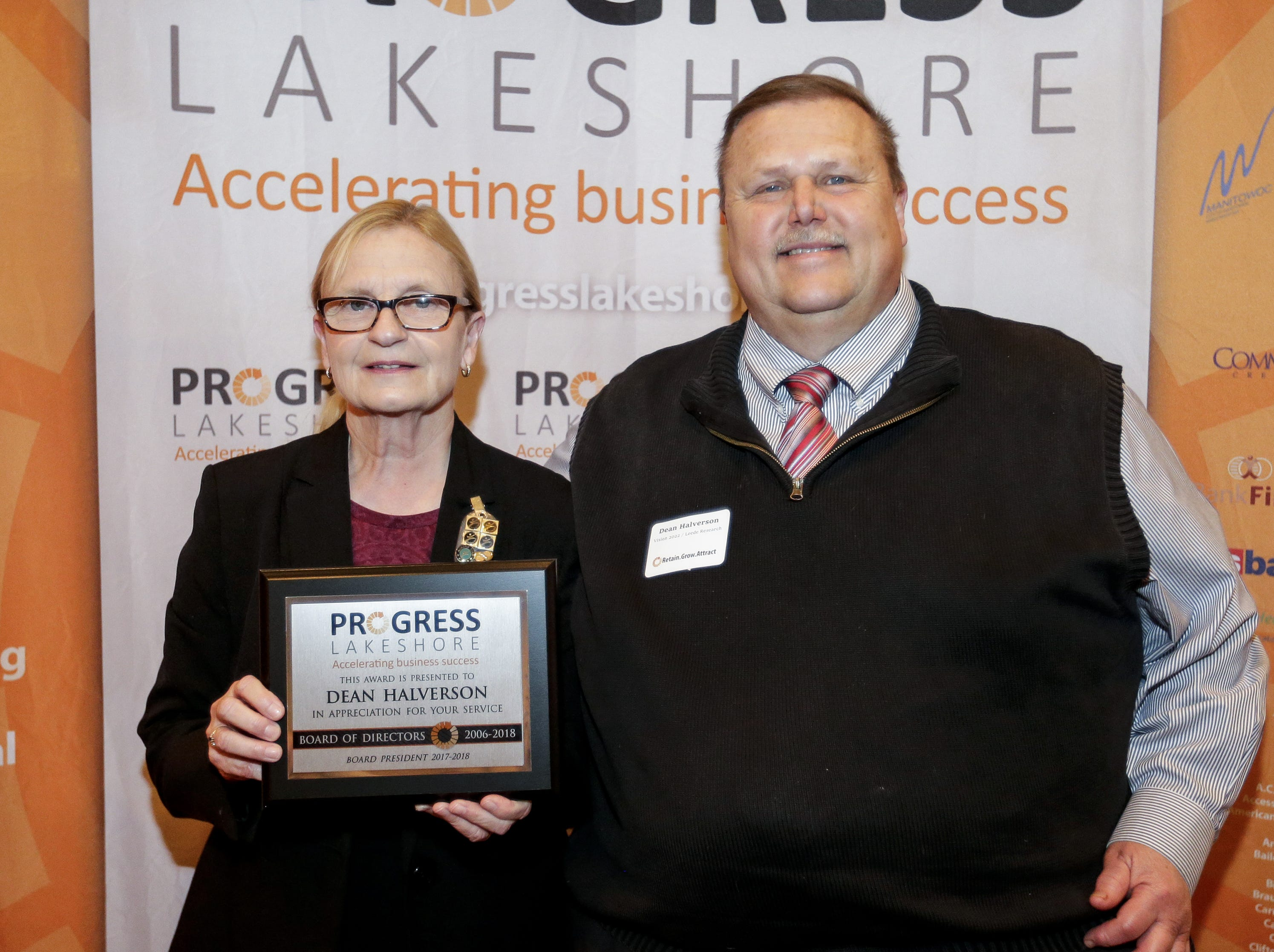 Outgoing Progress Lakeshore board member Dean Halverson is presented an award for his service by President Cathie Kocourek during the Progress Lakeshore Awards Breakfast at the Holiday Inn Tuesday, May 14, 2019, in Manitowoc.