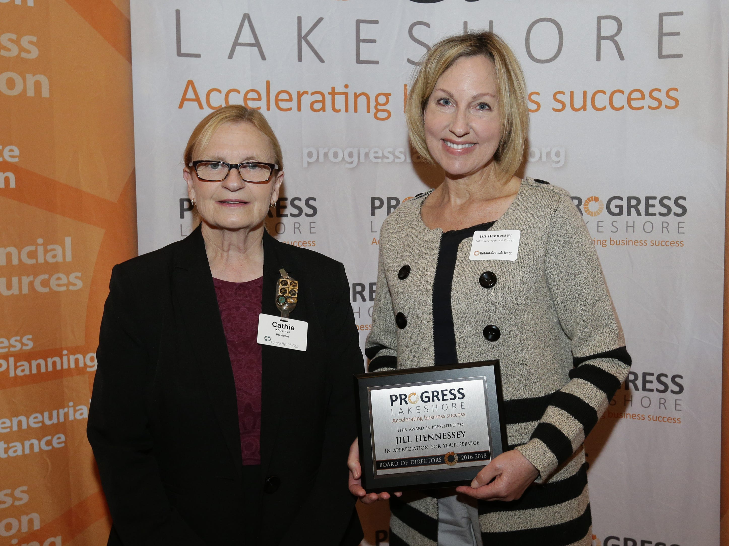Outgoing Progress Lakeshore board member Jill Hennessey is presented an award for her service by President Cathie Kocourek during the Progress Lakeshore Awards Breakfast at the Holiday Inn Tuesday, May 14, 2019, in Manitowoc.