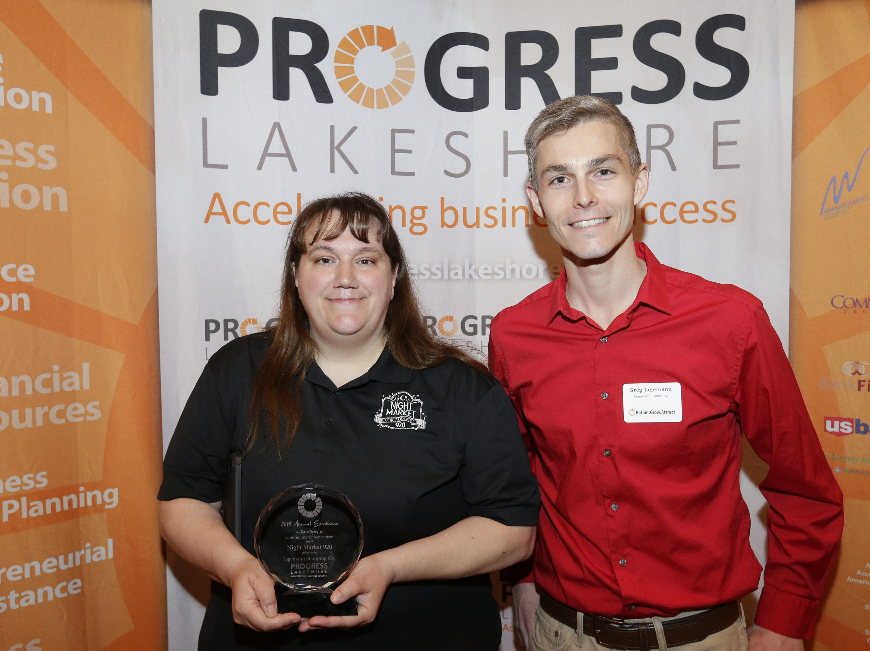 Night Market 920's Amber Daugs accepts the Community Enhancement Award from sponsor Greg Jagemann during the Progress Lakeshore Awards Breakfast at the Holiday Inn Tuesday, May 14, 2019, in Manitowoc.