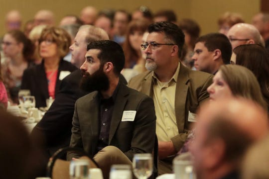 Audience members listen to the progress report during the Progress Lakeshore Awards Breakfast at the Holiday Inn Tuesday, May 14, 2019, in Manitowoc.
