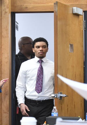 Deshawn Dowdell enters the courtroom for his jury trial in front of Judge Brent Robinson. Dowdell, 24, is charged with murder, two counts of discharging a firearm at or near a prohibited area and improper handling of a firearm in a motor vehicle in connection with the April 2018 shooting death of Terrence Harris, 19.