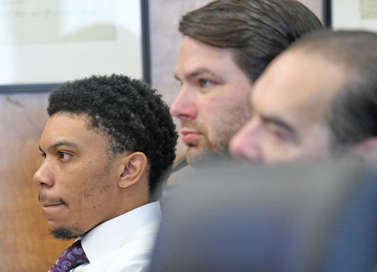 Deshawn Dowdell appears in court with his legal team for his jury trial in front of Judge Brent Robinson. Dowdell, 24, is charged with murder, two counts of discharging a firearm at or near a prohibited area and improper handling of a firearm in a motor vehicle in connection with the April 2018 shooting death of Terrence Harris, 19.