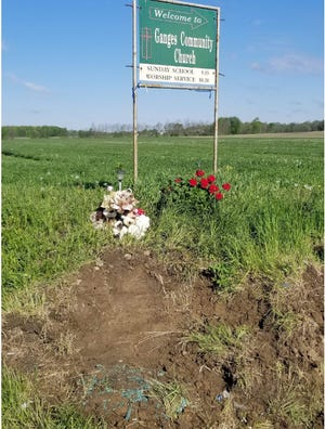 Josh Boggs placed red geraniums at the intersection of Ohio 96 and Ganges Five Points Road where a May 5 crash resulted in the deaths of two daughters and an unborn baby and left his wife Stacey in the ICU of OhioHealth Mansfield Hospital. Rumble strips are being placed at the site this week.