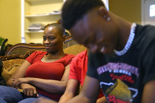 Rontavian Green, right, a pitcher from Raleigh Egypt whose brothers were hurt in the Orange Mound Youth bus crash, dedicated his season to his siblings. He is seen here sharing a laugh with his mother Charolette Bell at the family home on Thursday, May 9, 2019.