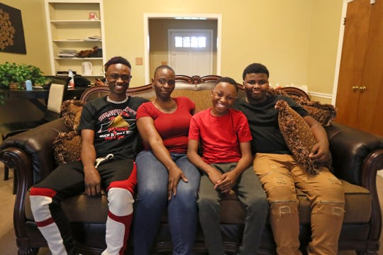 Rontavian Green, 18, a pitcher from Raleigh Egypt whose brothers were hurt in the Orange Mound Youth bus crash, dedicated his season to his siblings. He is seen here at the family home with brothers James, 13, and Jalen Gibbs, 11, and their mother Charolette Bell on Thursday, May 9, 2019.