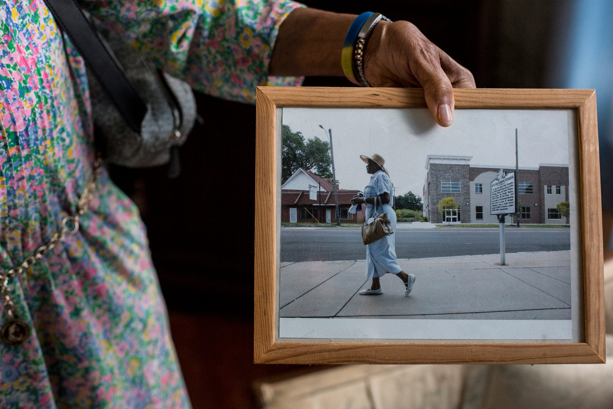 Everlena Yarbrough, 74, a resident of Soulsville for 42 years, shows off a picture on April 23, 2019, of her walking in front of the Stax Recording Studios historic marker.