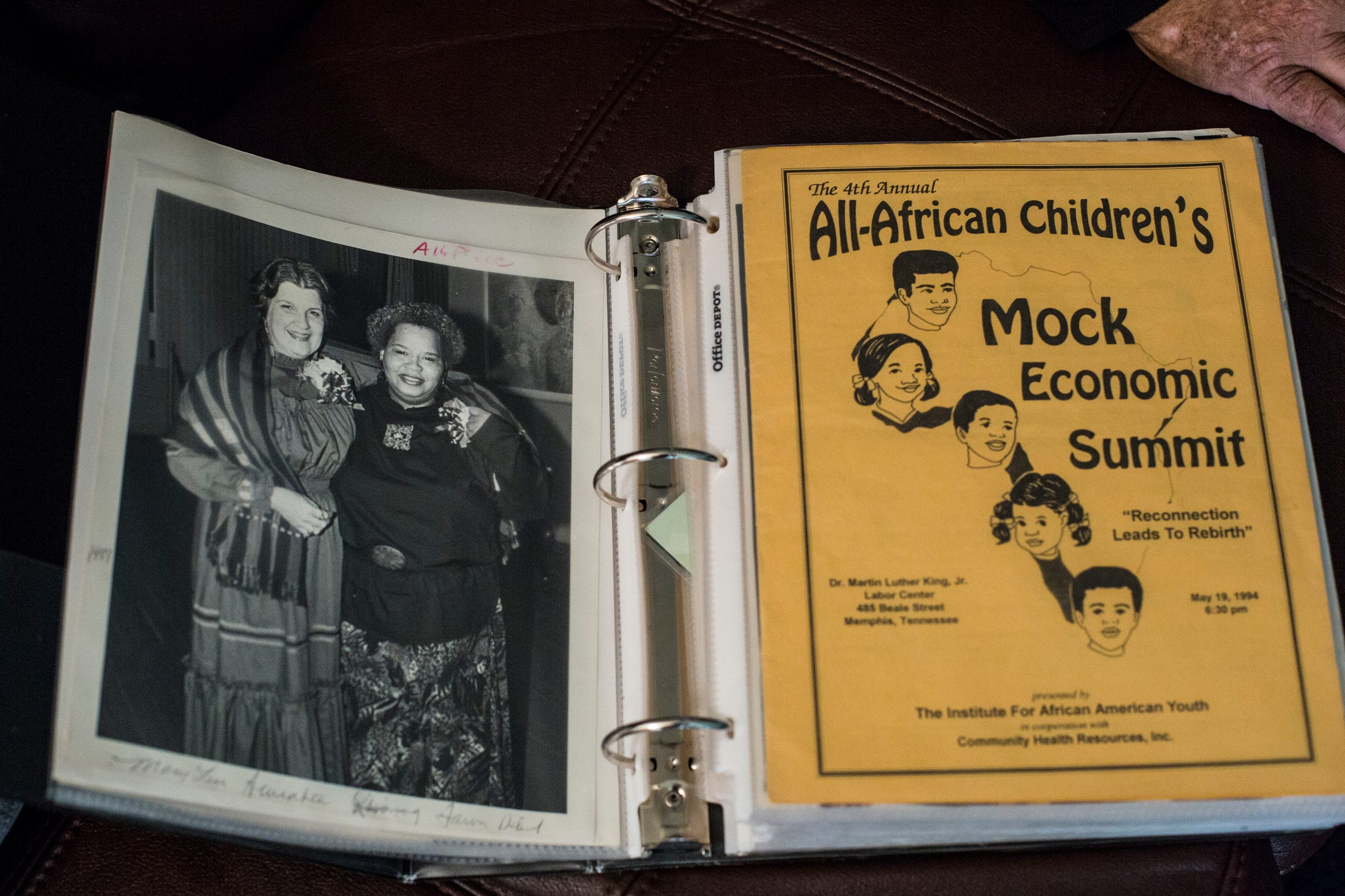 Ruby O'Gray shows off pictures in one of her scrapbooks at her home in South Memphis on April 23, 2019.