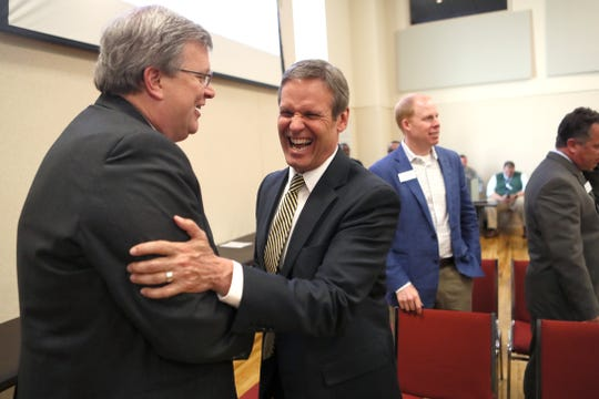 Gov. Bill Lee shares a laugh with Mayor Jim Strickland as they were both on hand Tuesday at Shelby County Schools Teaching and Learning Academy to announce the Tennessee Builders Education Foundation high school curriculum launch to address workers shortage in homebuilding industry.
