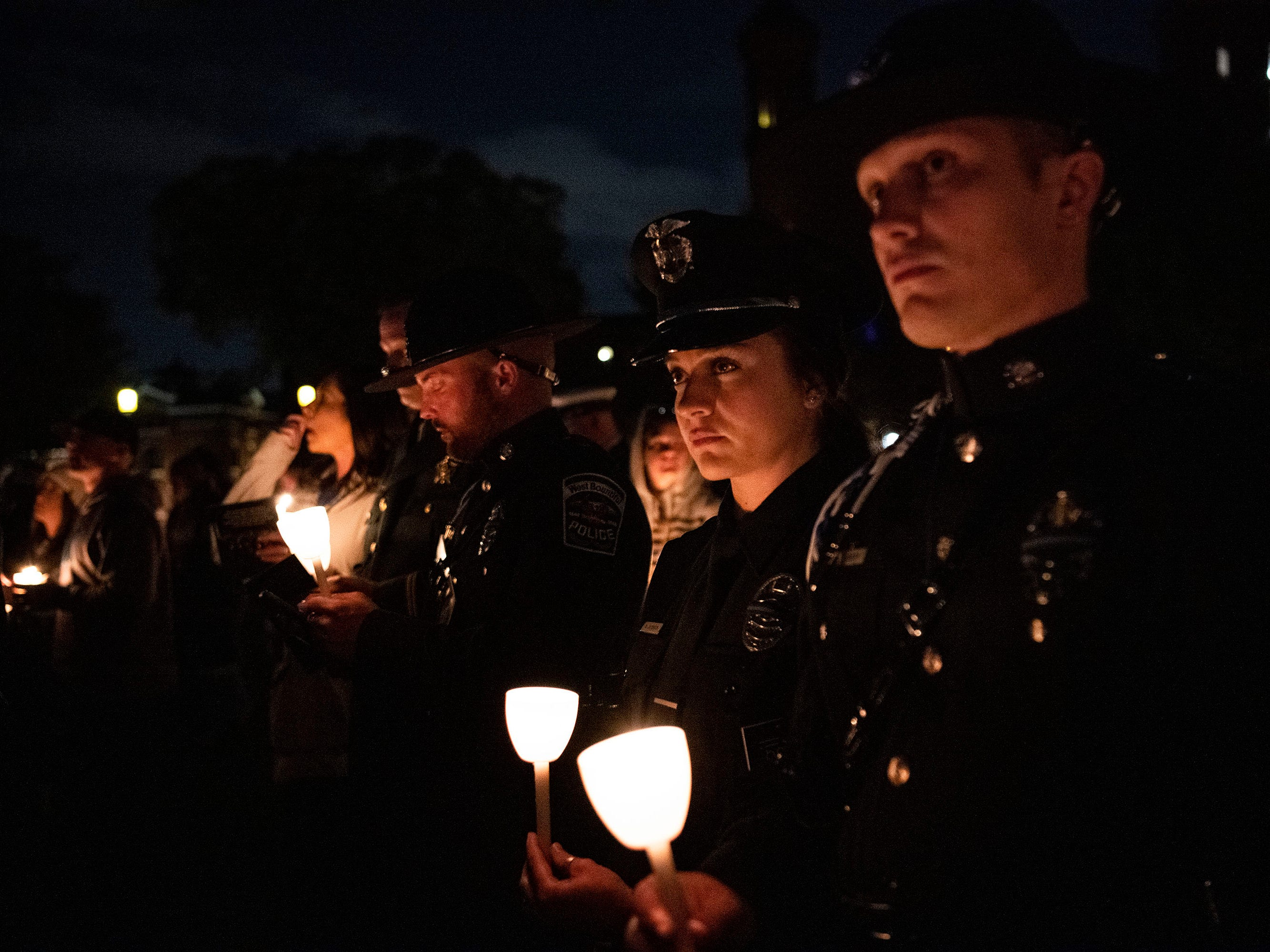 Law enforcement officers from all over the country joined thousands of attendees on the National Mall for a candlelight vigil to honor slain law enforcement officers as part of Police Week in the nation's capital.