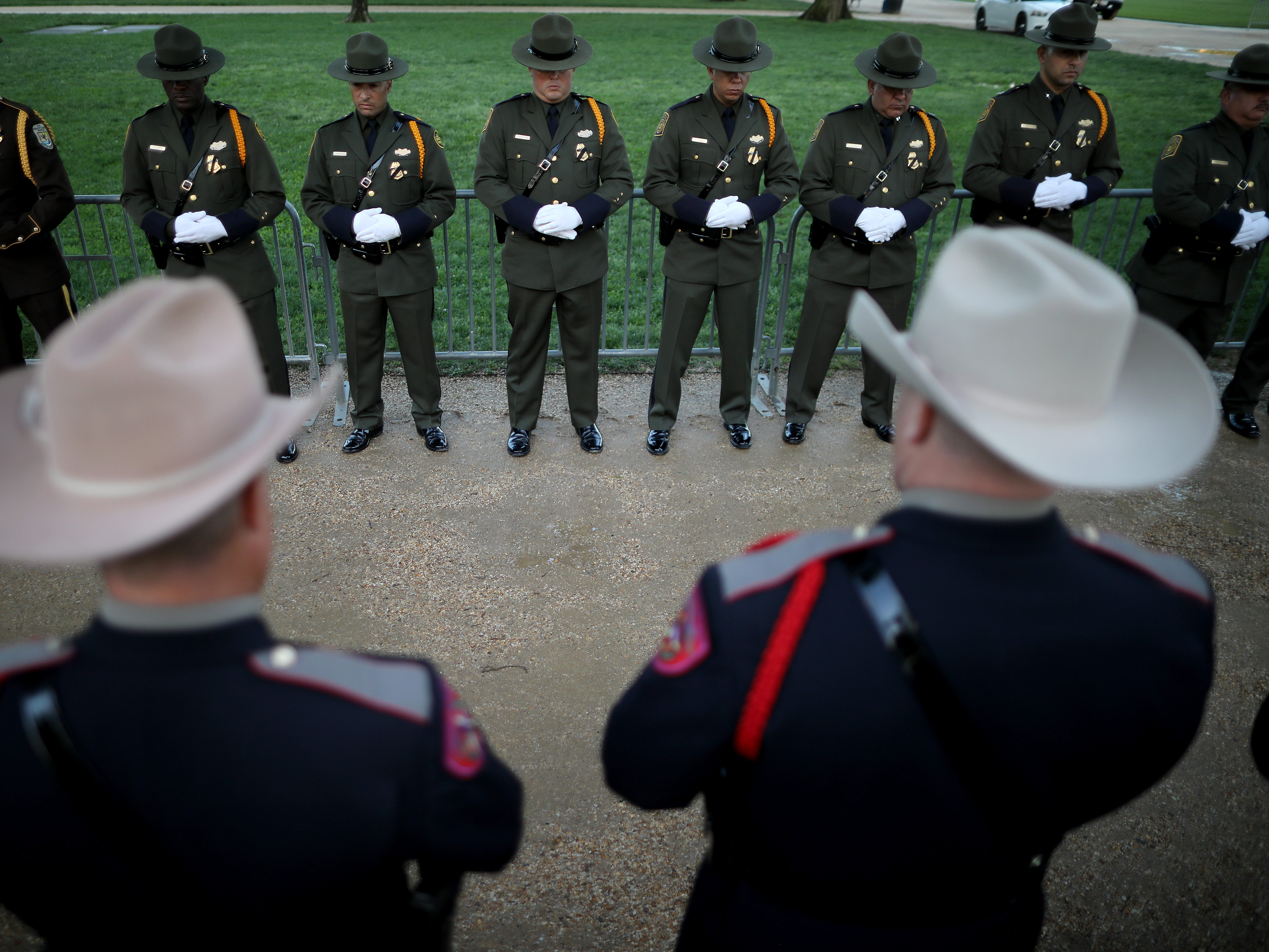 Law enforcement officers prepare for the National Police Week 31st Annual Candlelight Vigil on the National Mall.