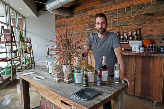 Bittercube co-founder Ira Koplowitz is ready to mix drinks at Bittercube Bar & Bazaar, 4828 W. Lisbon Ave. The small company does pay attention to how bitters can enhance food as well as drinks.