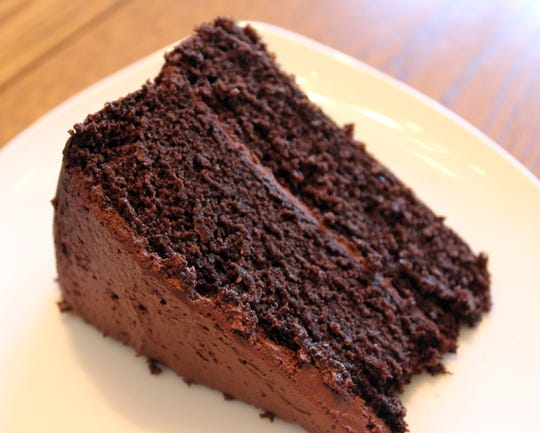 Honey Chocolate Cake with Rich Frosting is moist, dense, chocolaty rich and not too sweet, with a slight, unexpected kick of spice.
