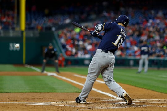 Keston Hiura singles in his first at-bat in the major leagues Tuesday night.