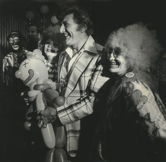 "Liberace, shown at a 1978 news conference to announce plans for a Liberace museum in Wauwatosa, appeared on ""Saturday Night Live"" in 1985."