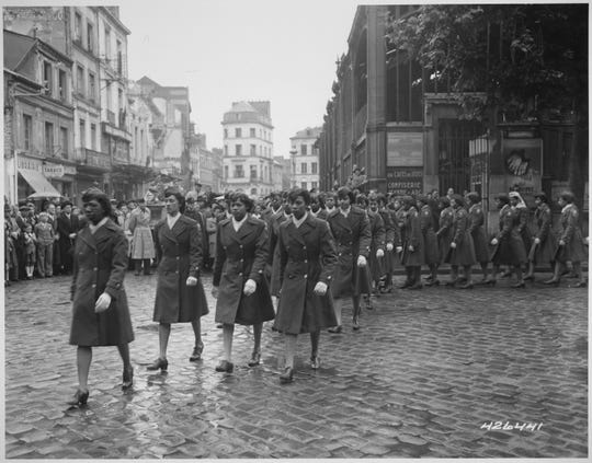 Soldiers in the Women's Army Corps 6888 Central Postal Directory Battalion march in a parade in Rouen, France, on Joan of Arc Day, May 30, 1945.