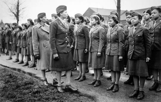 Maj. Charity Adams (foreground at right) and executive officer Capt. Abbie Campbell inspect soldiers in the Women's Army Corps 6888 Central Postal Directory Battalion in England during World War II. The unit was the only all-female battalion deployed overseas during the war.