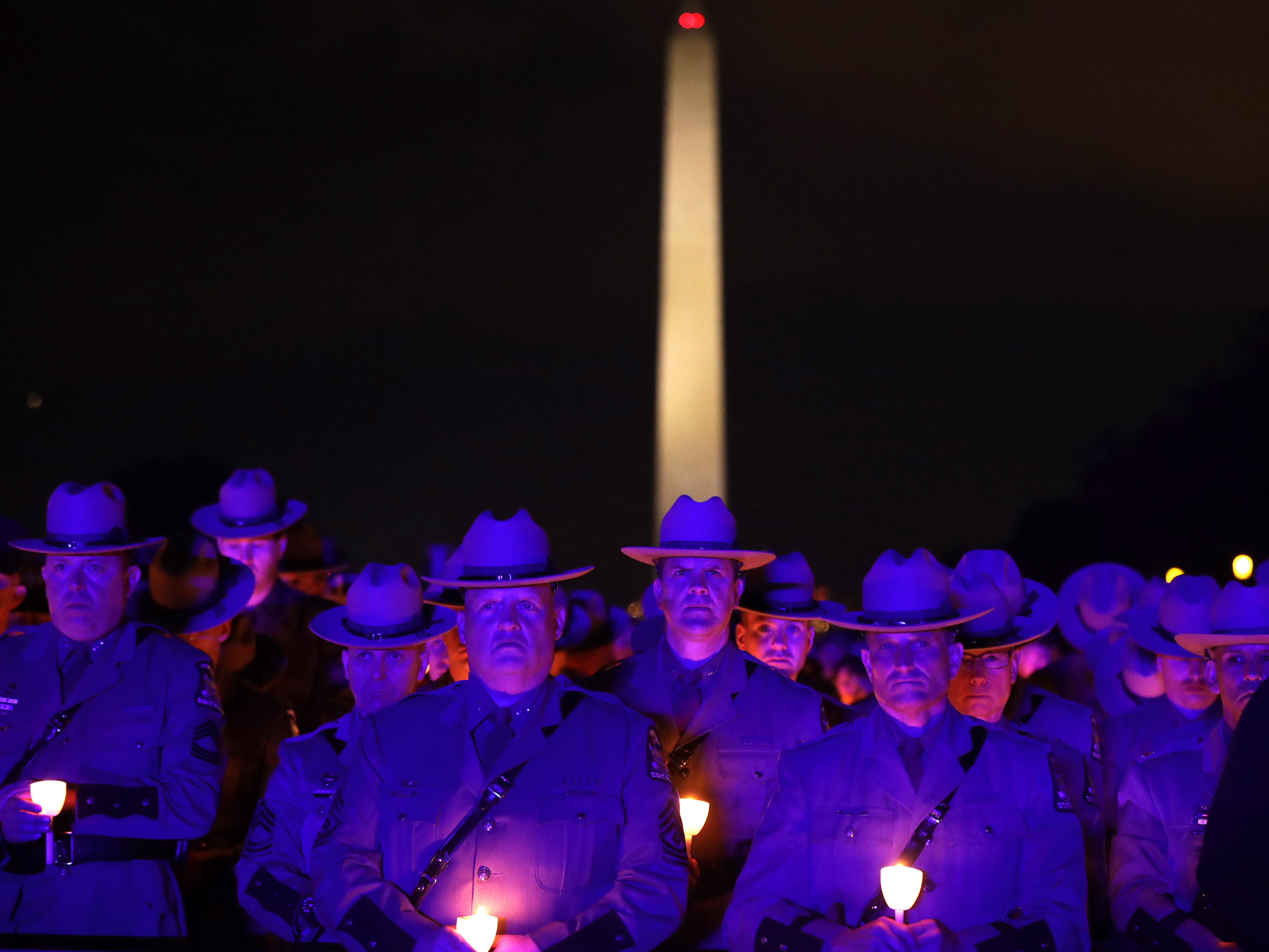Thousands of law enforcement officers and their family and supporters gather for the National Police Week 31st Annual Candlelight Vigil on the National Mall May  in Washington, D.C. Police, political leaders and family members of those officers who died in the line of duty gathered on the National Mall to remember and honor them.