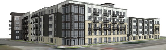This preliminary rendering of a five-story luxury apartment complex called The Reserve of Waukesha shows what a developer has in mind for a now-vacant commercial area near the Fox River and Waukesha State Bank downtown. As envisioned, the complex would include 186 units plus 2,100 square feet of commercial space.