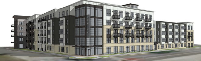 This preliminary rendering of a five-story luxury apartment complex called The Reserve of Waukesha shows what a developer has in mind for a now-vacant commercial area near the Fox River and Waukesha State Bank downtown. As envisioned, the complex would include 186 units plus more than 2,000 square feet of commercial space.