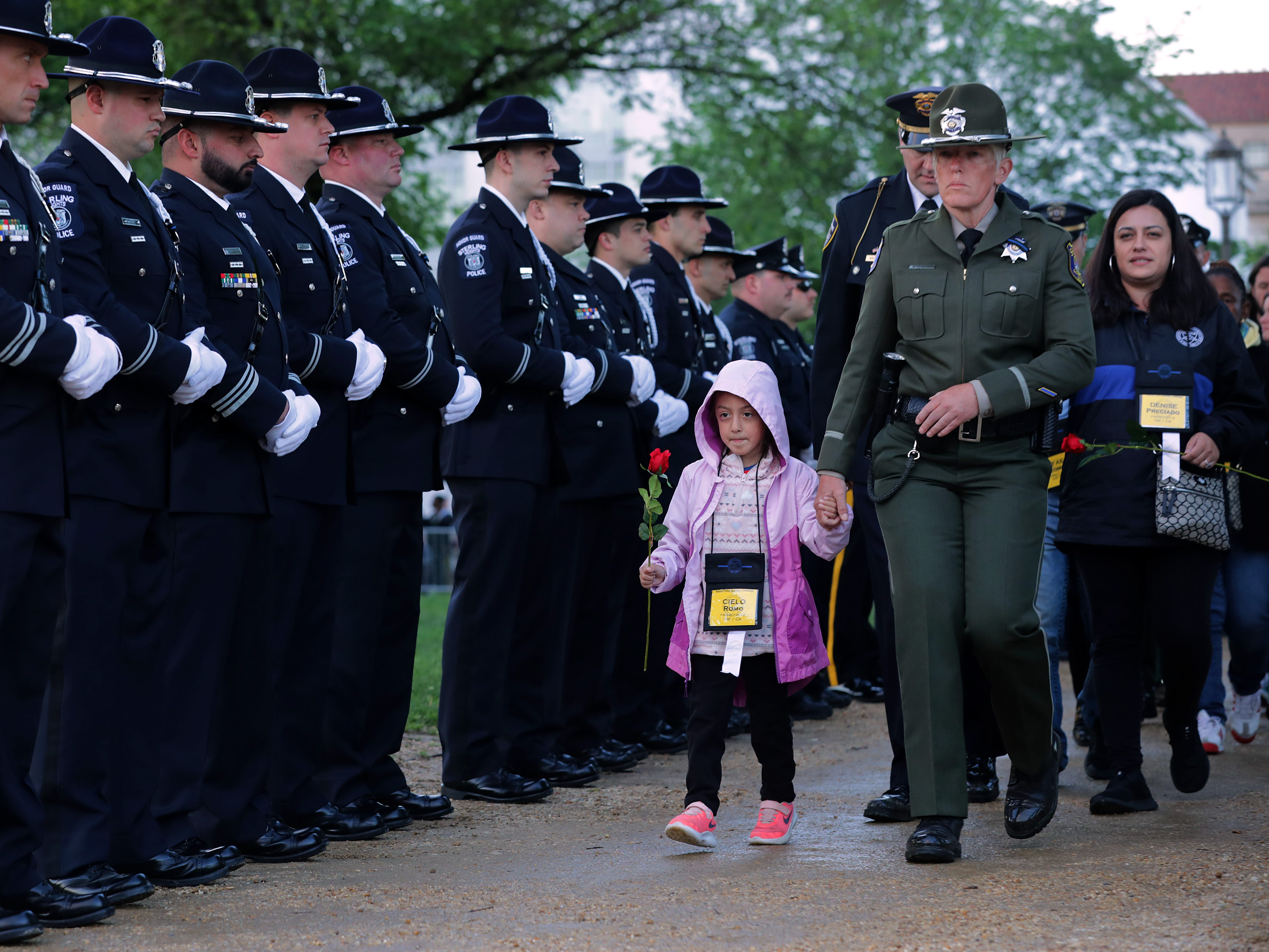 Family members of law enforcement officers who have died in the line of duty are escorted to the National Police Week 31st Annual Candlelight Vigil on the National Mall.
