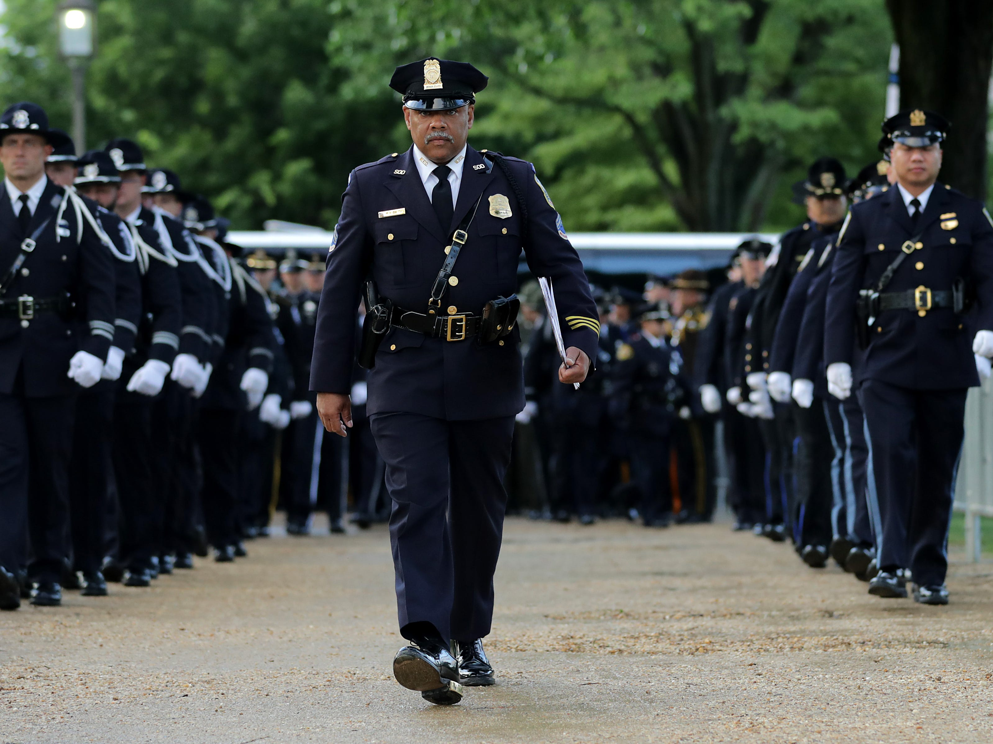 Law enforcement officers prepare for the National Police Week 31st Annual Candlelight Vigil.