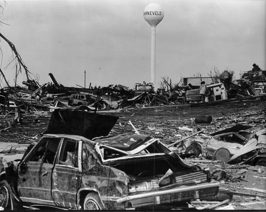 Cars lie in ruins near Barneveld's water tower.