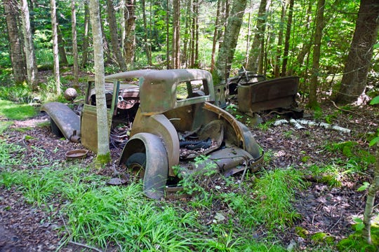 A 1930 Chevy Coupe and a Ford Model T sit abandoned on Sand Island in the Apostle Islands National Lakeshore.