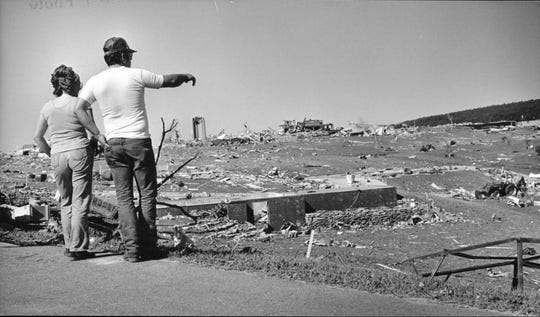 Meteorologists then, as today, relied on eyewitness reports.   Local residents survey piles of rubble in Barneveld.