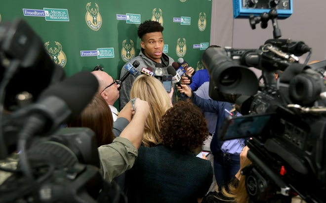 Bucks star Giannis Antetokounmpo answers questions from the media after practice on Tuesday.
