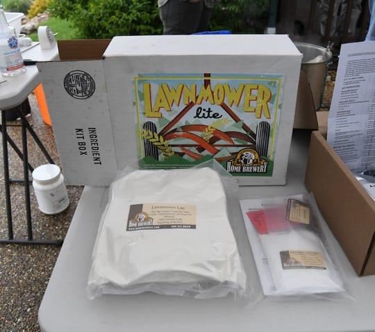 "A kit for ""Lawnmowday at the public demonstration held by the Twin Lakes er Lite"" craft beer sits on display Saturday by the Twin Lakes Home Brewers. In craft beer parlance, a ""lawnmower beer"" is a light beverage one might drink wile mowing the lawn."