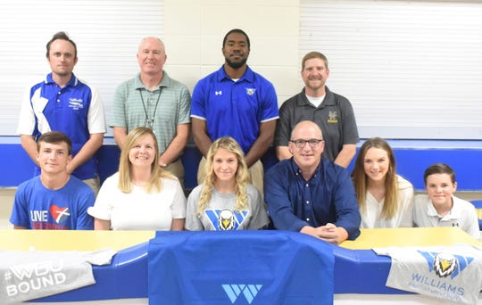 Mountain Home's Ka'Lee Daniel signed Tuesday a National Letter of Intent to run cross country and track at Williams Baptist University. Pictured at her signing ceremony are: (front row, from left) her brother Brayden Daniel, her mother Jennifer Daniel, Ka'Lee Daniel, her father Vince Daniel, her sister Vinessa Daniel, her brother Parker Daniel, (back row) MHHS coach Ryder Pierce, MHHS coach Clint Pevril, Williams Baptist coach Tim Shepard, and MHHS head track coach Philip Goodwin.