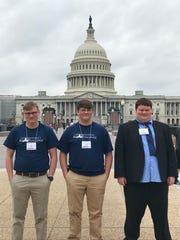 Garrett Gray, Zach Reddick and Wyatt Wiggins wait in front of the U.S. Capitol  before presenting their app to members of Congress.