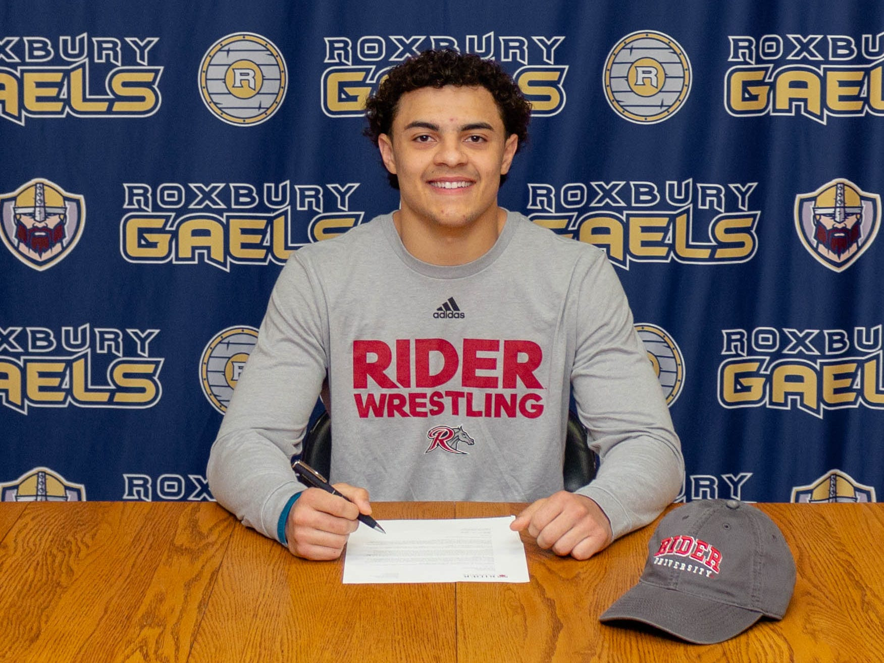Roxbury senior Evan Vazquez signed a National Letter of Intent with Rider wrestling on Friday.