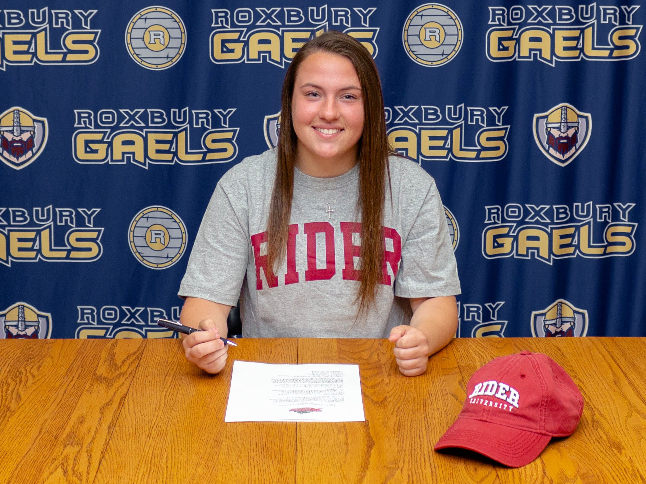 Roxbury senior Jenna Segrave signed a National Letter of Intent with Rider field hockey on Friday.