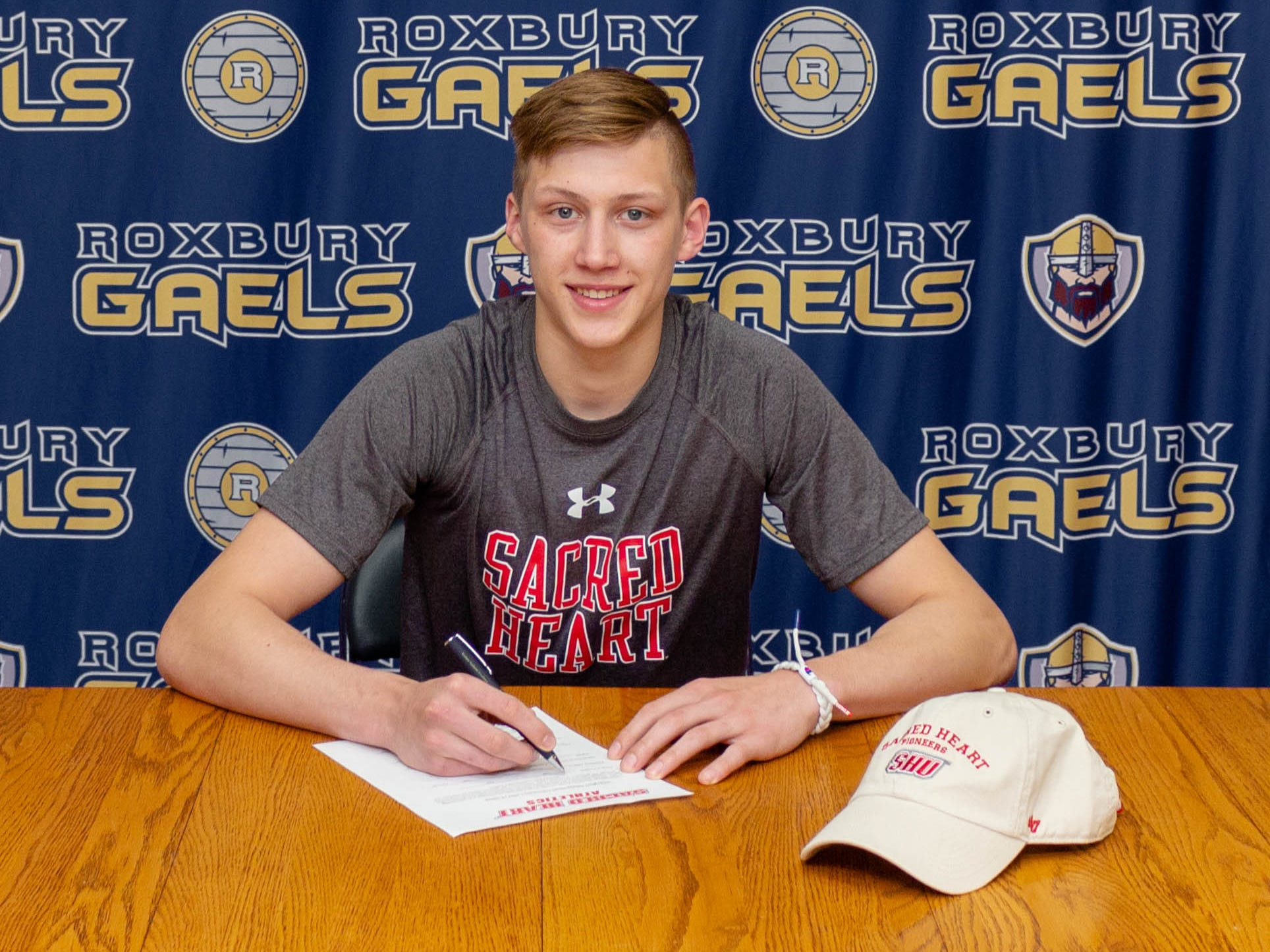 Roxbury senior Scott Yarosz signed a National Letter of Intent with Sacred Heart wrestling on Friday.