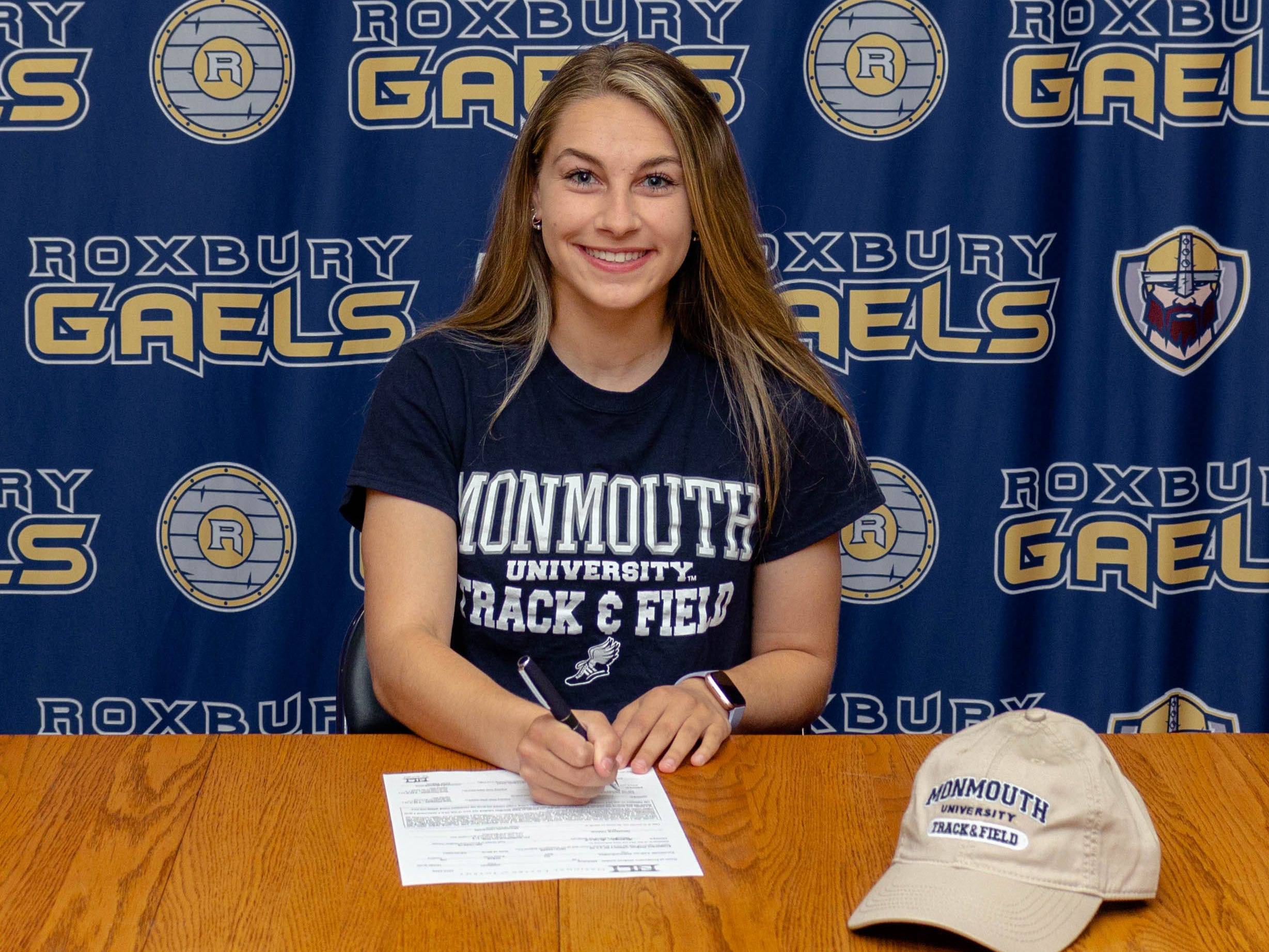 Roxbury senior Jordan Morris signed a National Letter of Intent with Monmouth track and field on Friday.