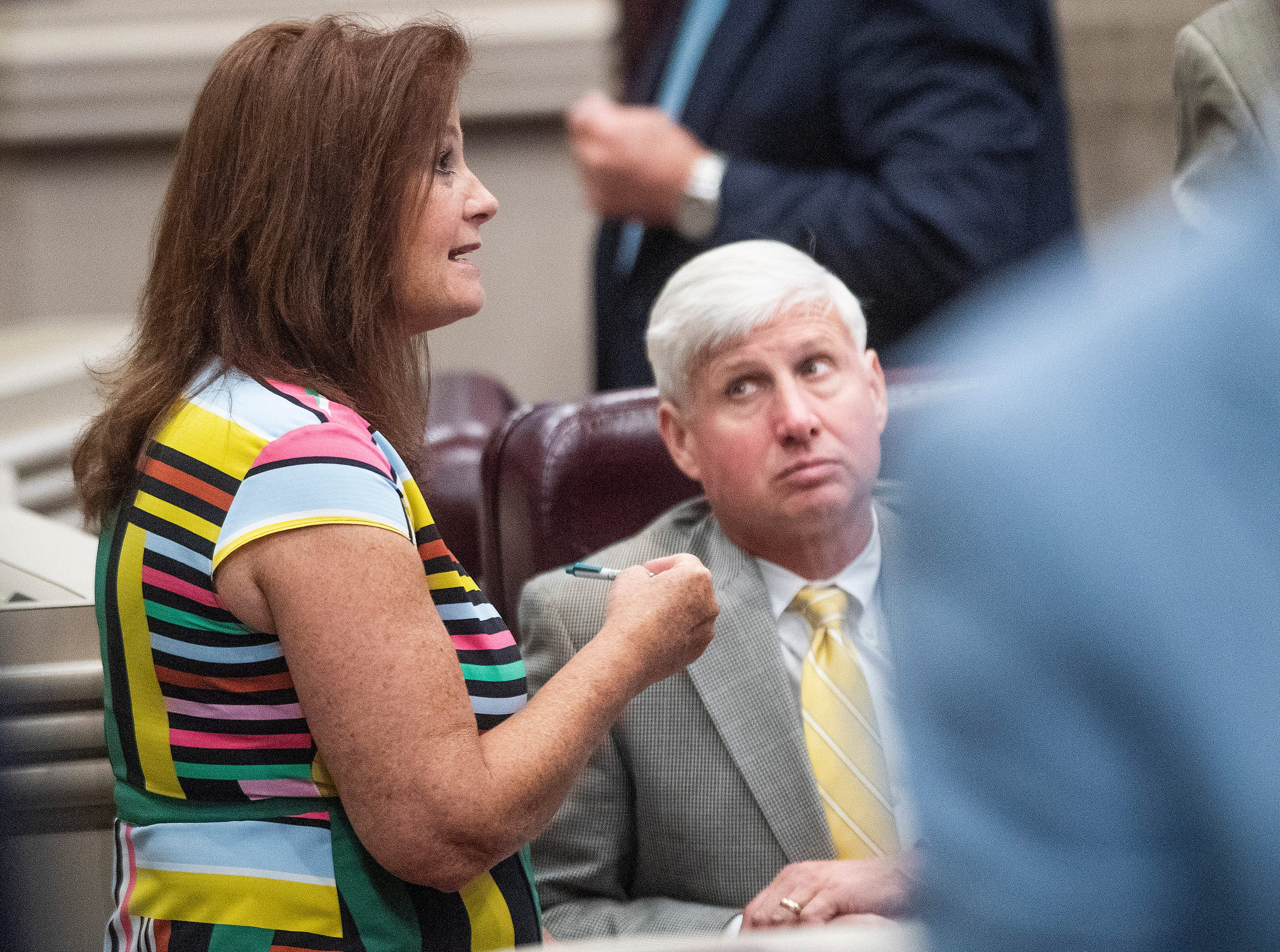 Rep. Terri Collins, right, chats with Rep. Alan Baker on the house floor at the Alabama Statehouse in Montgomery, Ala., on Tuesday May 14, 2019. Rep. Collins is the sponsor of HB314, the near-total ban on abortion bill.