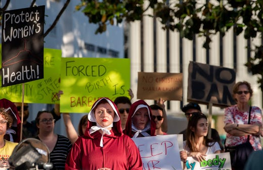 Margeaux Hartline, dressed as a handmaid, during a rally against HB314, the near-total ban on abortion bill, outside of the Alabama Statehouse in Montgomery, Ala., on Tuesday May 14, 2019.