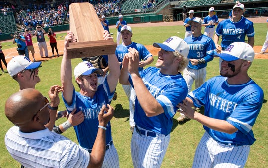 Mars Hill players claim their State Championship trophy after defeating Brantley in the AHSAA 1A State Championship Game at Riverwalk Stadium in Montgomery, Ala., on Tuesday May 14, 2019.