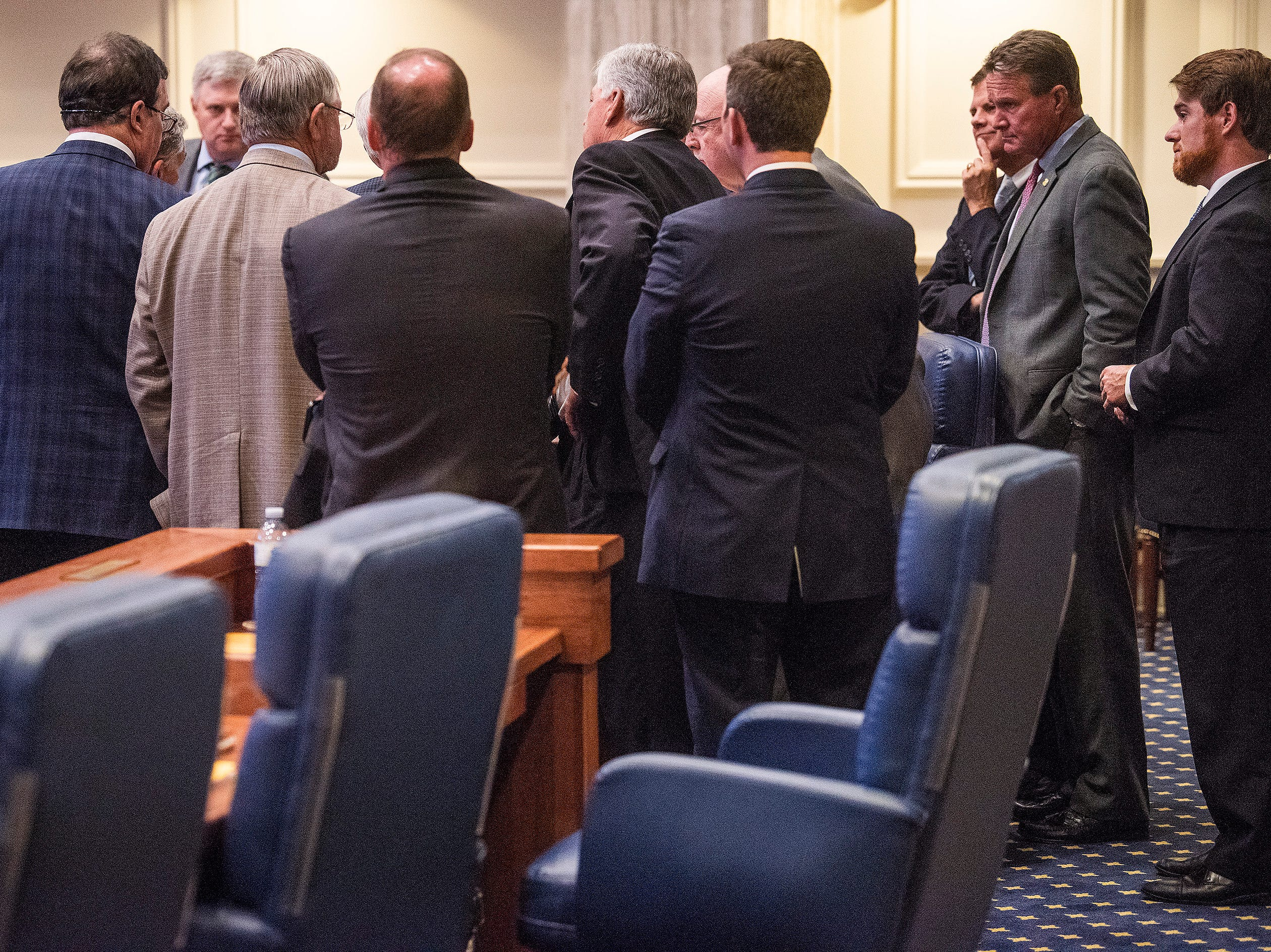 Republican Senators group together as debate on HB314, the near-total ban on abortion bill, is held in the senate chamber in the Alabama Statehouse in Montgomery, Ala., on Tuesday May 14, 2019.