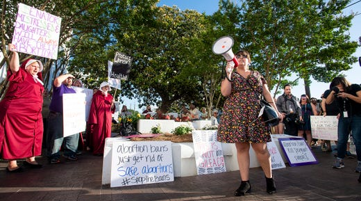 Lucia Hermo leads chants during a rally against HB314, the near-total ban on abortion bill, outside of the Alabama Statehouse in Montgomery, Ala., on Tuesday May 14, 2019.