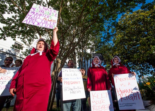 Bianca Cameron-Schwiesow, left, chants during a rally against HB314, the near-total ban on abortion bill, outside of the Alabama Statehouse in Montgomery, Ala., on Tuesday May 14, 2019.