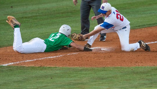Brantley's Tucker Kilcrease dives safely back to third against Mars Hill's Peyton Higgins in the AHSAA 1A State Championship Series in Montgomery, Ala., on Monday May 13, 2019.